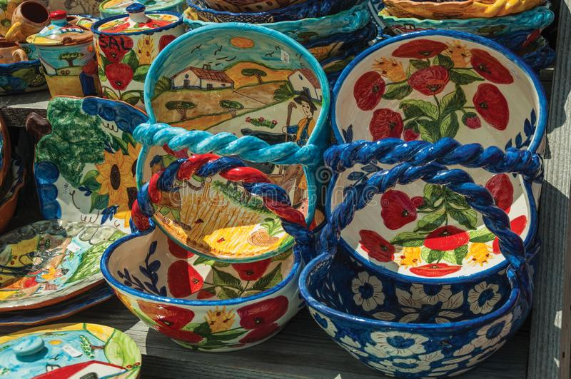 Colorful handmade porcelain pots and dishes. Typical of the region, in a gift shop at the Serra da Estrela. The highest mountain range in continental Portugal stock photo