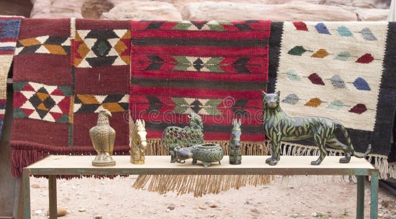 Colorful handmade woolen rugs and bronze animal figures, Petra, Jordan stock image