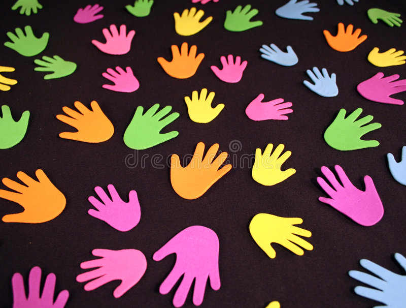 Colorful Hands. A group of different colored hand prints royalty free stock images