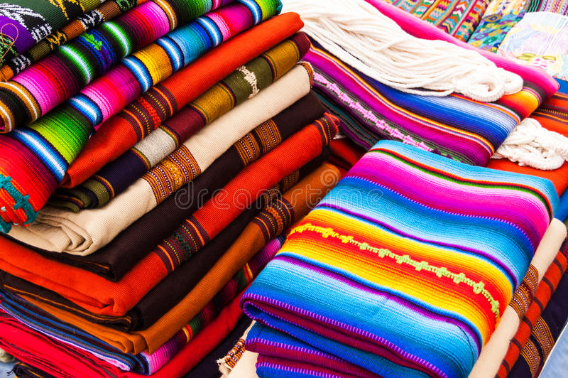 Colorful handwoven Guatemalan textiles. Typical colorful handwoven textiles at an open air market in Antigua, Guatemala stock photography