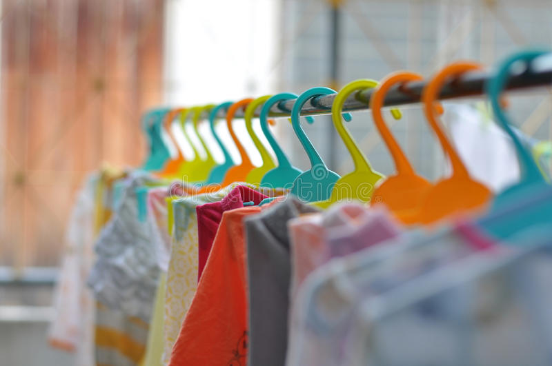 The colorful hangers are arranged in a neat and orderly manner. The colorful hangers are arranged in a neat stock photos