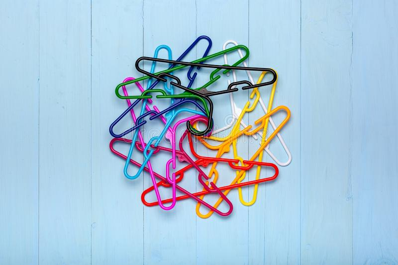 Colorful hangers one above the other stock photo