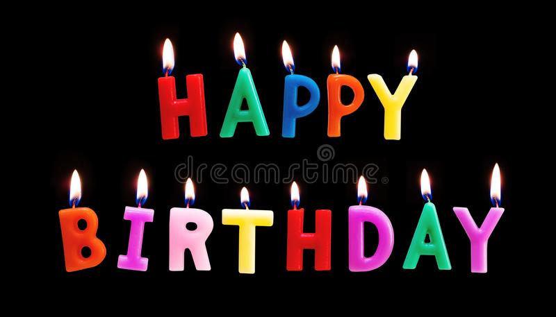 Colorful Happy Birthday Candles, on black background. S royalty free stock images