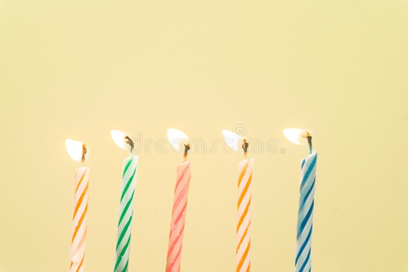 Colorful happy birthday candles close-up  with a pastel background royalty free stock photo
