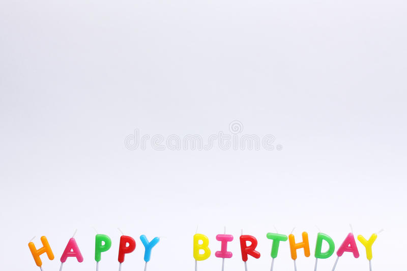 Colorful happy birthday candles on white background. Horizontal stock photography