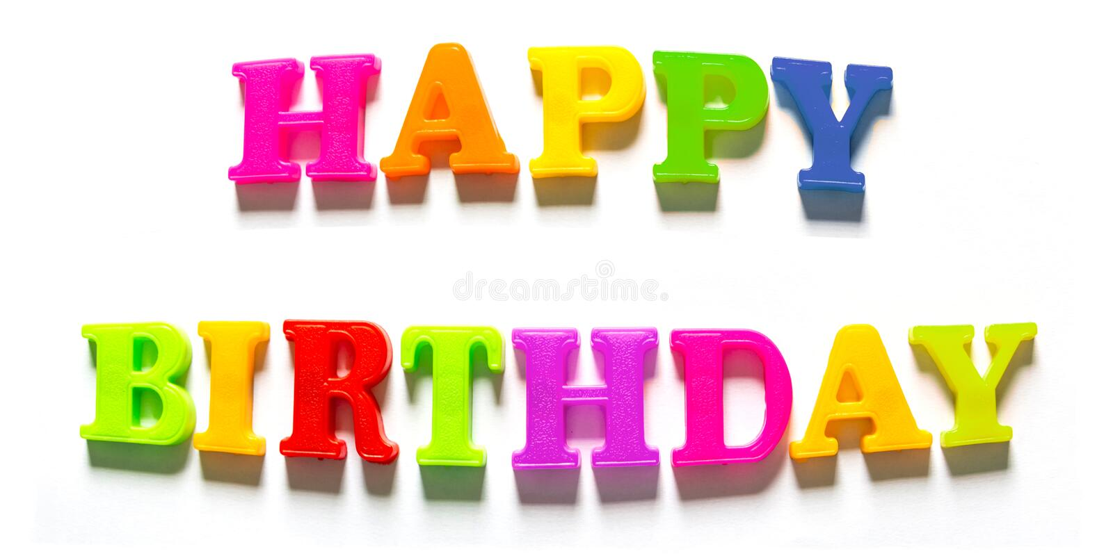 Colorful Happy Birthday Capital Letters in White Background. Image of happy birthday words made from colourful plastic letter magnets with inflating effect in stock images