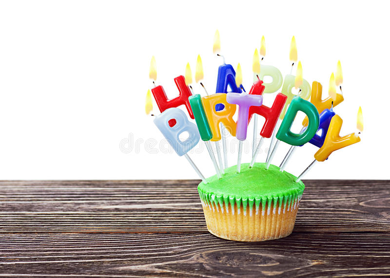 Colorful happy birthday cupcake with candles royalty free stock image