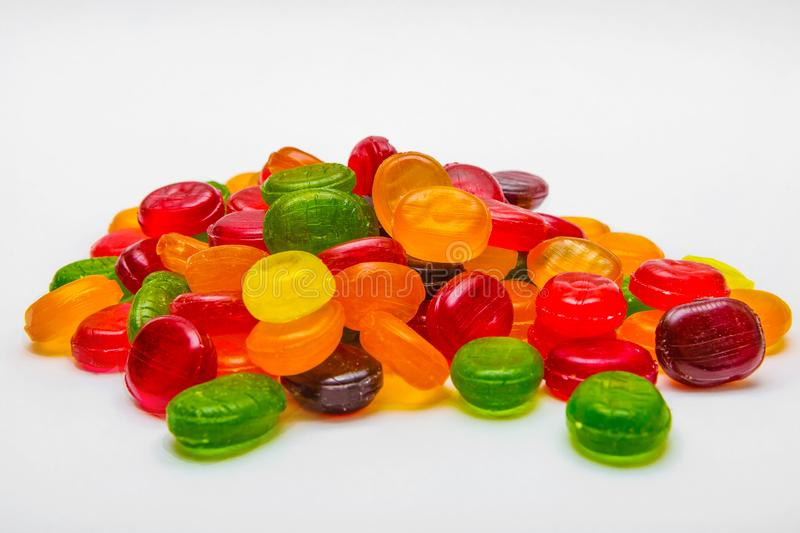 Colorful hard candies on a white background stock photography
