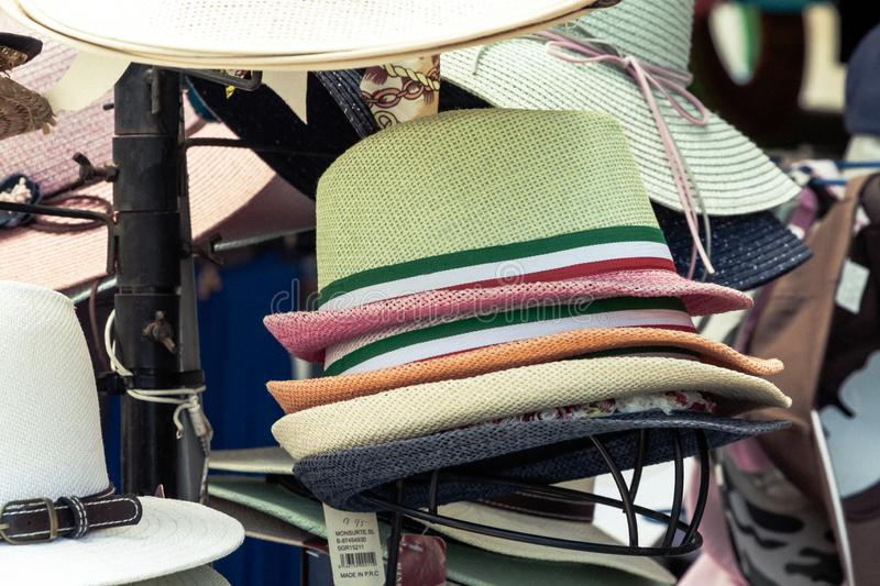 Colorful hats on the beach royalty free stock image