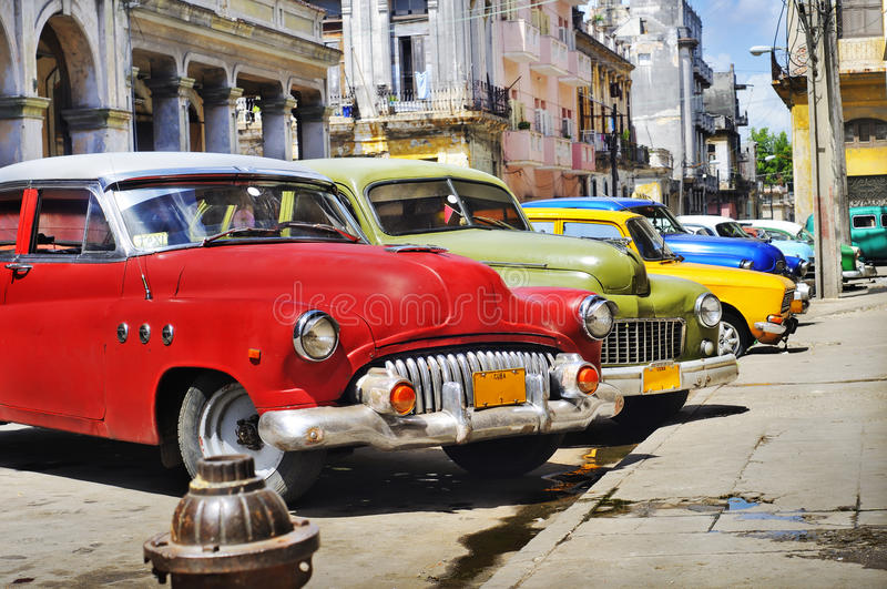 Colorful Havana cars. Detail of colorful group of vintage american cars parked in a street of Old havana