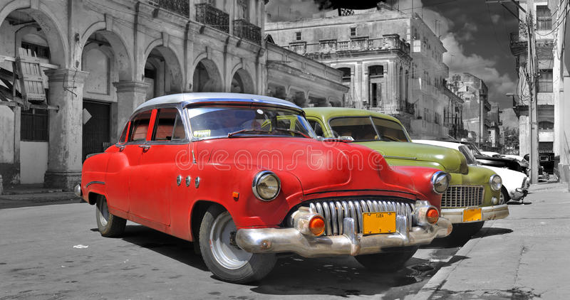 Colorful Havana cars panorama. Panoramic view of colorful vintage classic cars parked in street of old Havana, cuba stock photography