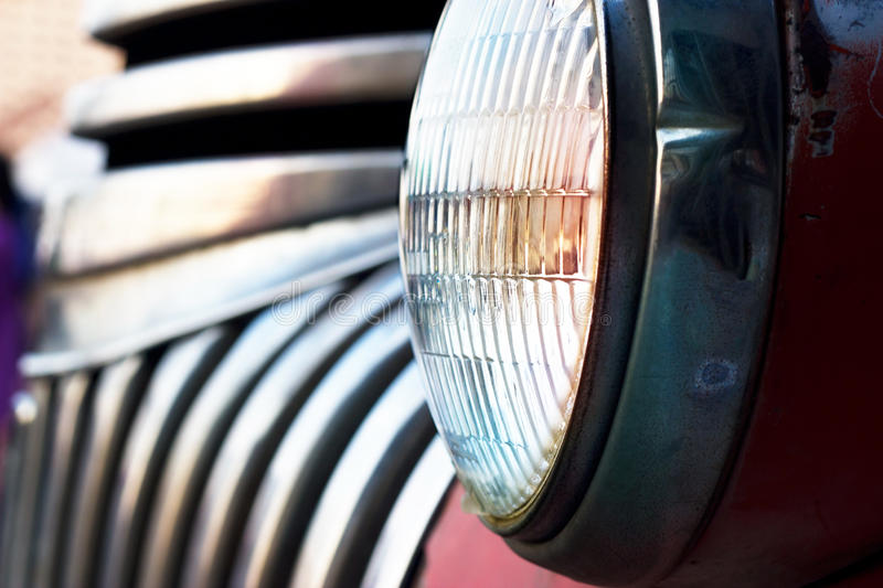 Colorful head light vintage car on dark tone. Soft focus and blur royalty free stock image