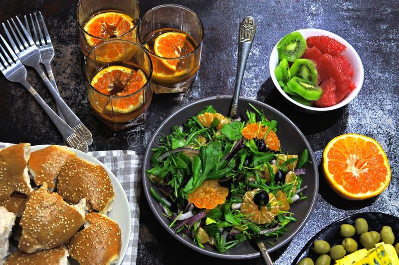 Colorful, healthy foods in flatlay style. Toned. Healthy food and drinks on the table. Green salad with mandarin orange. delicious royalty free stock photo