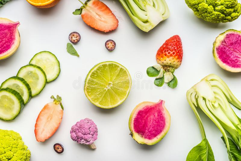 Colorful healthy fruits and vegetables for clean eating and detox diet nutrition on white. Vegetarian food flat lay. Vitamin. Content of fruit and vegetables royalty free stock images