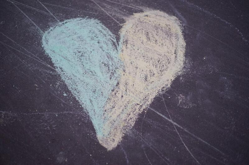 Colorful heart chalk drawing on a pedestrian pavement, asphalt. Colorful heart chalk drawing - drawn by a child on a pedestrian pavement, asphalt royalty free stock photography