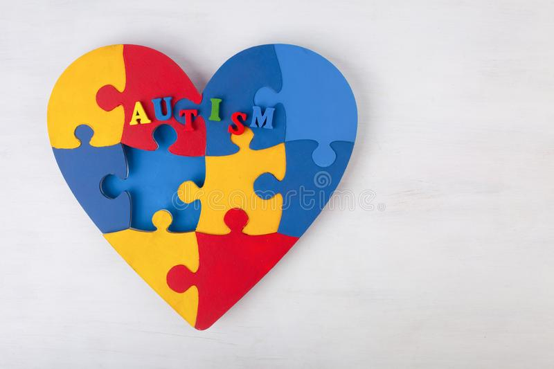 A colorful heart made of symbolic autism puzzle pieces. royalty free stock photo
