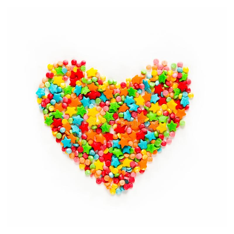 Colorful heart shape of different multicolored sprinkles. Beautiful bright sweet heart on white background. Colorful heart shape of different multicolored stock photos