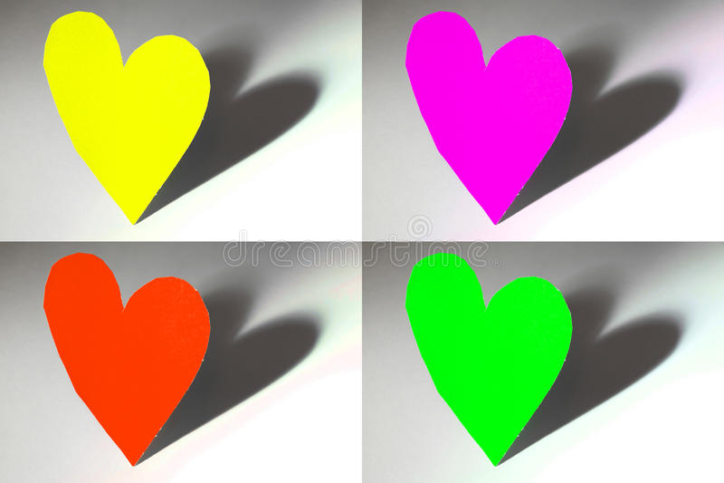 Colorful hearts. Real cut out colorful paper hearts for your romantic or healthcare copy - note that as the paper is real, there is some texture in those hearts stock image