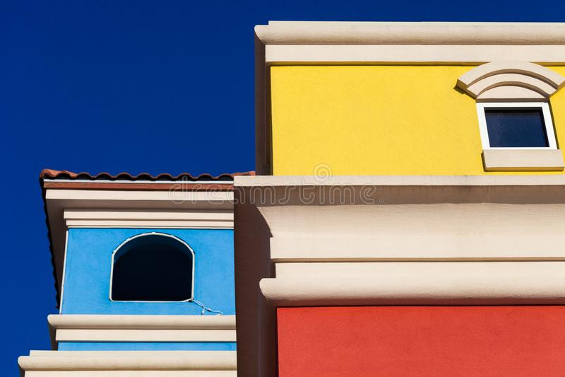 Colorful Hispanic style building facade with bright blue sky in. The background stock image