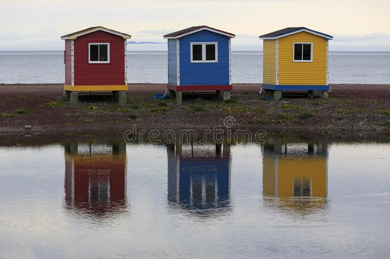 Colorful historic fish storage sheds royalty free stock photography