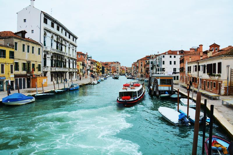 Colorful historical buildings and boats, in Venice, Italy royalty free stock photography