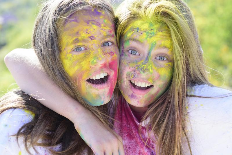 Colorful holi on painted face Drycolors. colorful neon paint makeup. children with creative body art. Crazy hipster. Girls. Summer weather. Happy youth party stock image
