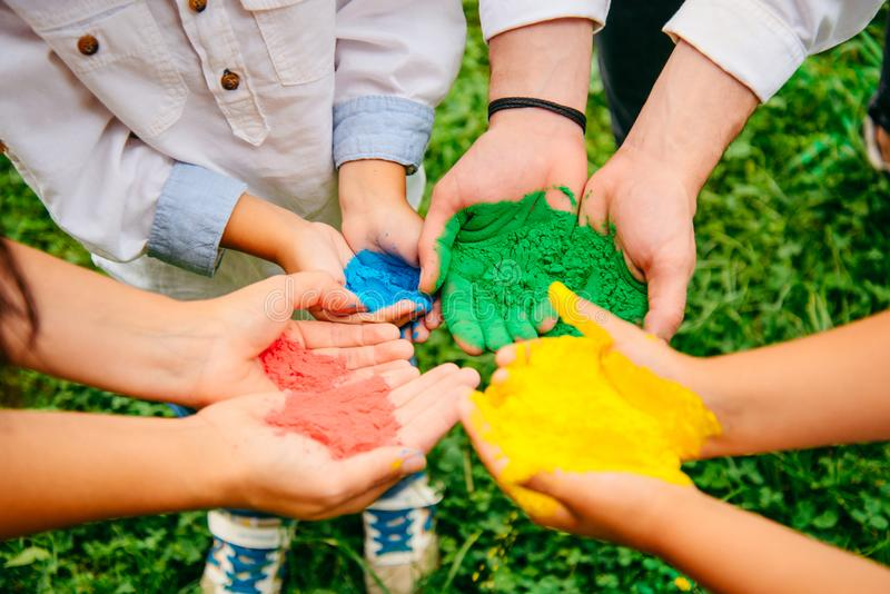 Colorful holi painted hands royalty free stock photography