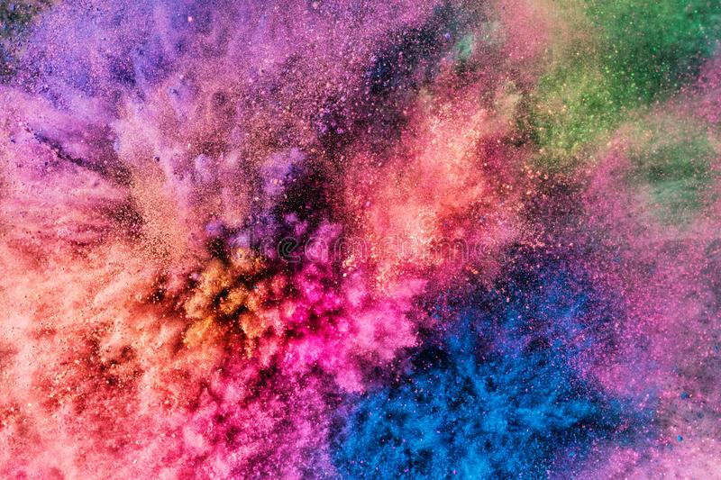 Colorful holi powder blowing up. royalty free stock photography