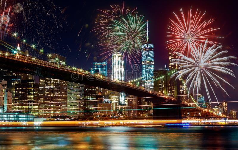 Colorful holiday fireworks panoramic view New York city Manhattan downtown skyline at night royalty free stock images
