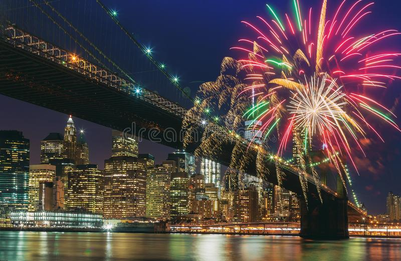 Colorful holiday fireworks panoramic view New York city Manhattan downtown skyline at night stock photography