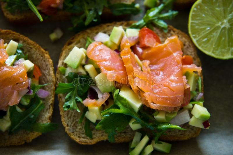 Homemade healthy sandwiches with salmon and avocado stock photography