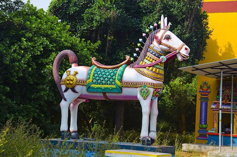 Colorful Horse at the entrance of the temple, on the way to Auroville Village, Pondicherry, Tamil Nadu, India. Colorful Horse at the entrance of the temple, on royalty free stock image