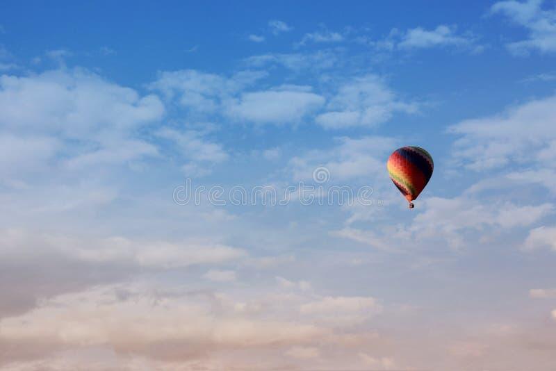 Colorful hot air ballon in a blue sky stock photo