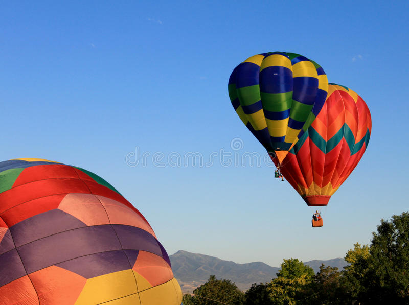 Colorful Hot Air Ballons Launching royalty free stock photography