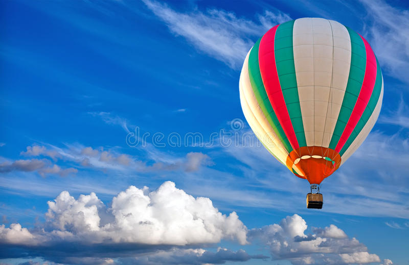 Colorful hot air balloon on blue sky royalty free stock photos