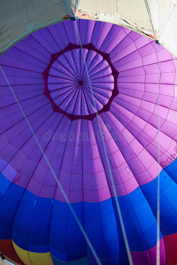Colorful hot air balloon. In blue sky at sunset royalty free stock image