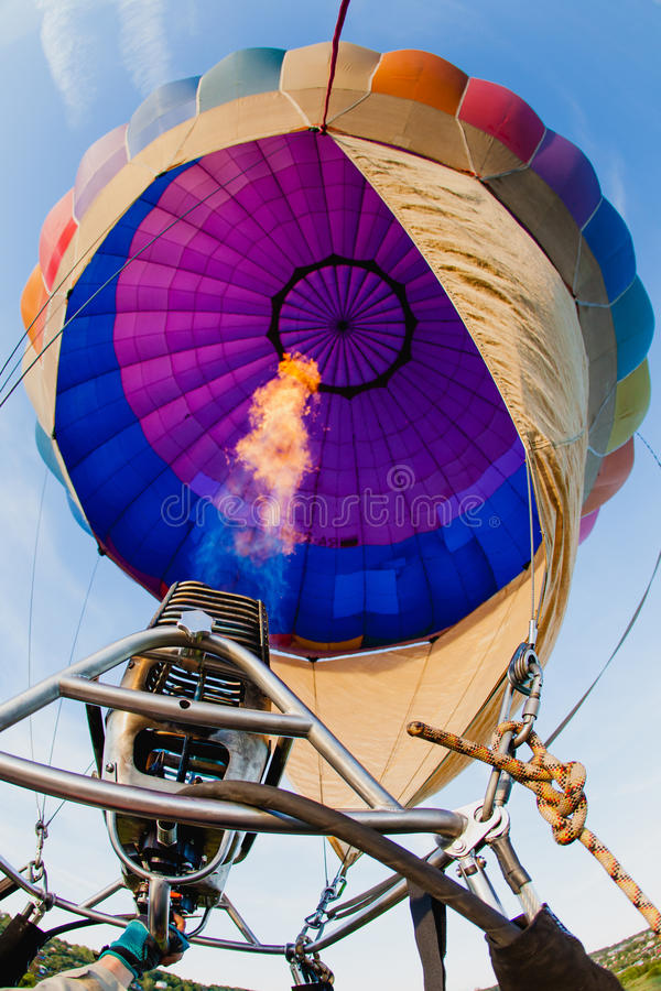 Colorful hot air balloon in blue sky. At sunset stock images