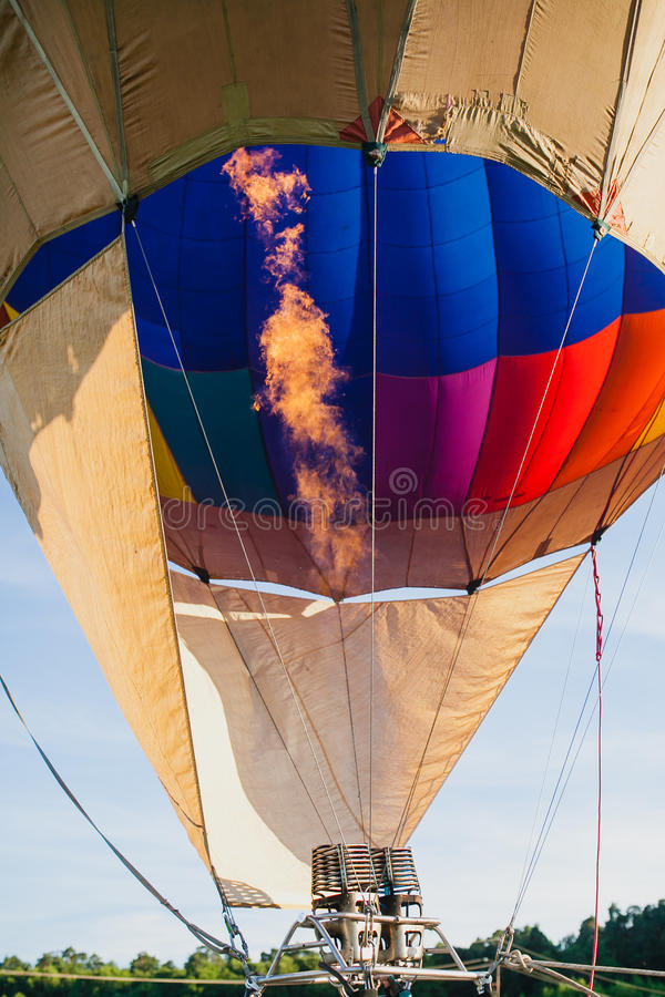 Colorful hot air balloon in blue sky. At sunset royalty free stock photography