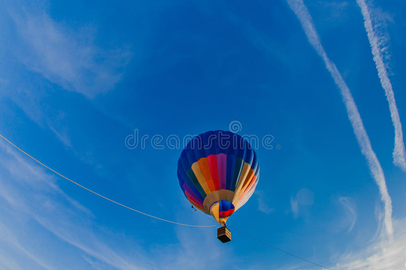 Colorful hot air balloon in blue sky. At sunset royalty free stock photo