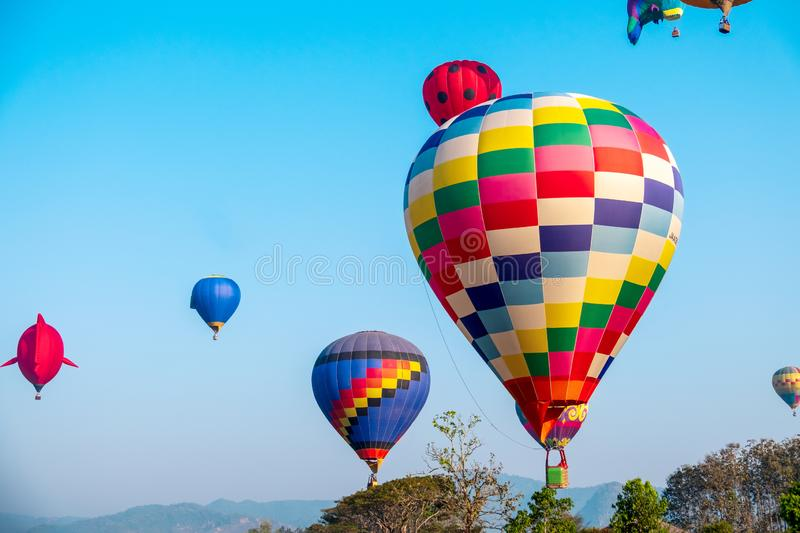 Colorful hot air balloon over mountain on blue sky royalty free stock image