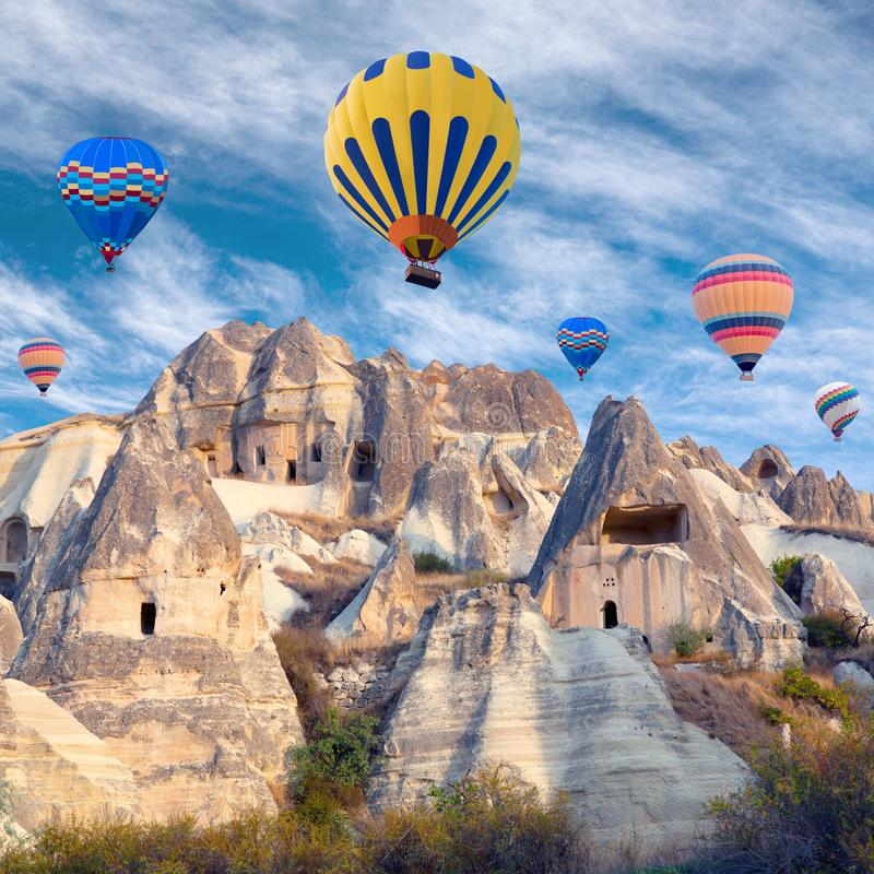 Colorful hot air balloons flying over Cappadocia, Turkey royalty free stock photography