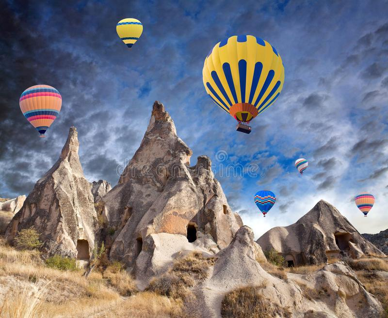 Colorful hot air balloons flying over Cappadocia, Turkey royalty free stock images