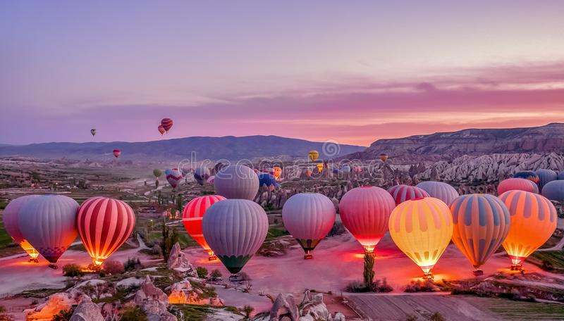 Colorful hot air balloons before launch in Goreme national park, Cappadocia, Turkey royalty free stock photo