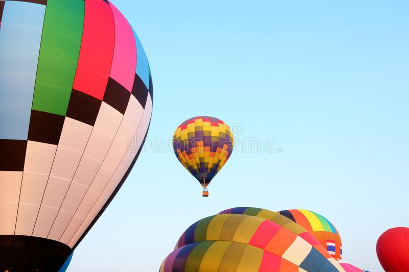 Colorful hot air balloons over blue sky background. royalty free stock photo