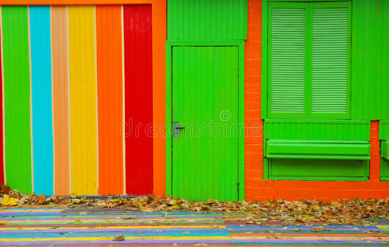 Colorful house. Bright colorful wall facade with green door and royalty free stock photo