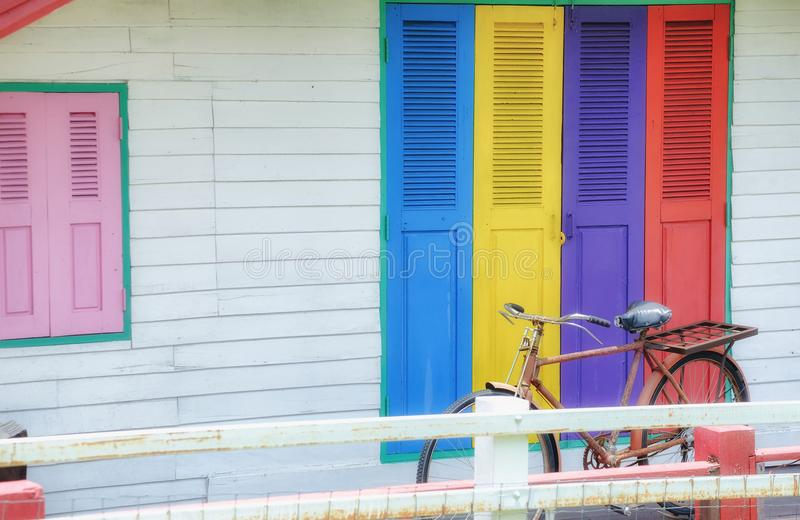 Colorful house doors and old bikes parked beautifully. royalty free stock photo