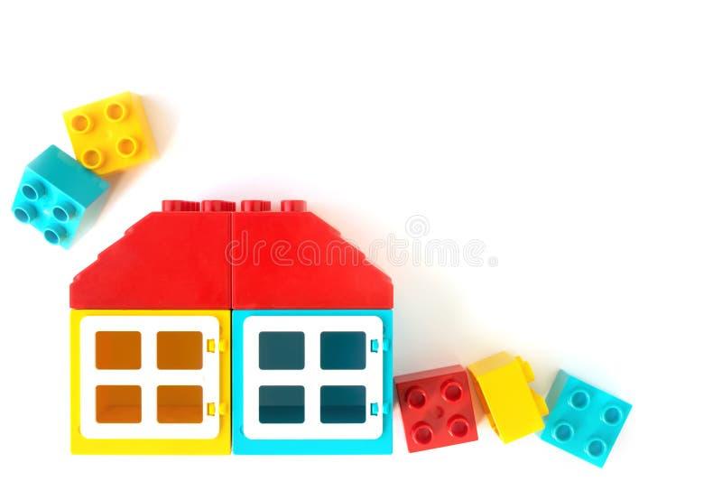 Lego bricks. House made of colorful plastic constructor bricks on white background. Popular toys. Colorful House made of Small and big plastic constructor bricks stock images