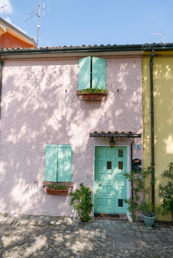 Colorful house in the old square with masonry basins originally used for the conservation of freshly caught fish. Today the local market royalty free stock photography
