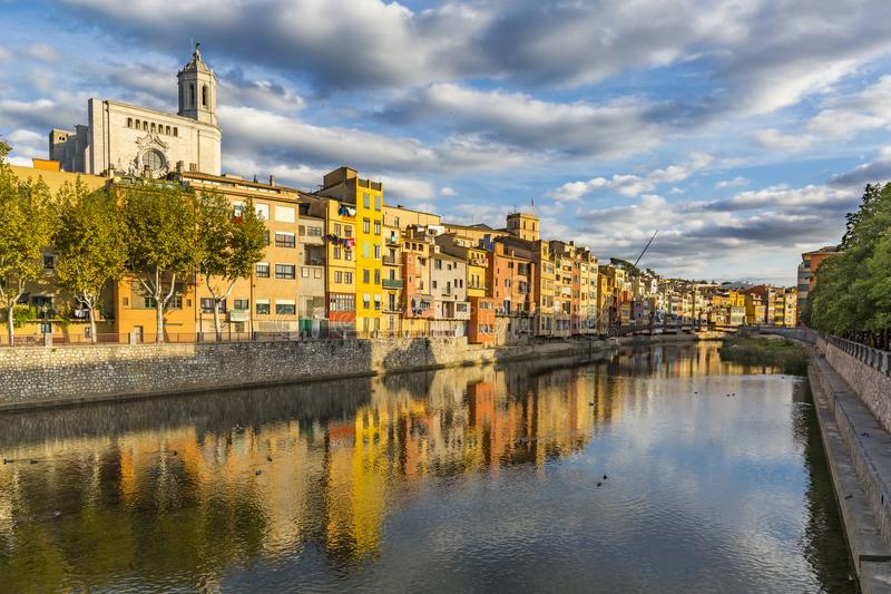 Colorful houses on the banks of the Onyar river in Girona stock image
