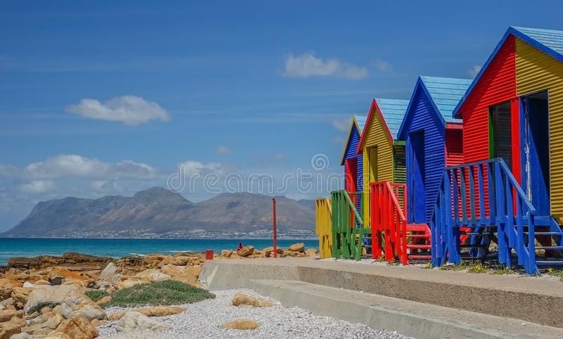 Colorful houses on the beach of St James, False Bay in Cape Town stock photography